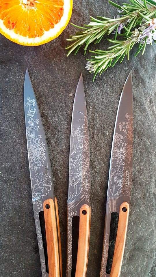 Lifestyle shot of Deejo Blossom set of 3 knives with lemon and herbs on a stone benchtop