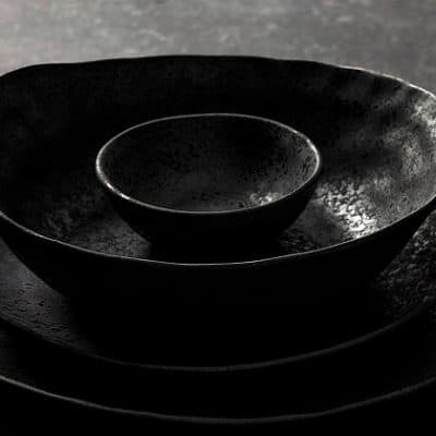 Beautiful product shot of the Rania collection of plates and bowls stacked