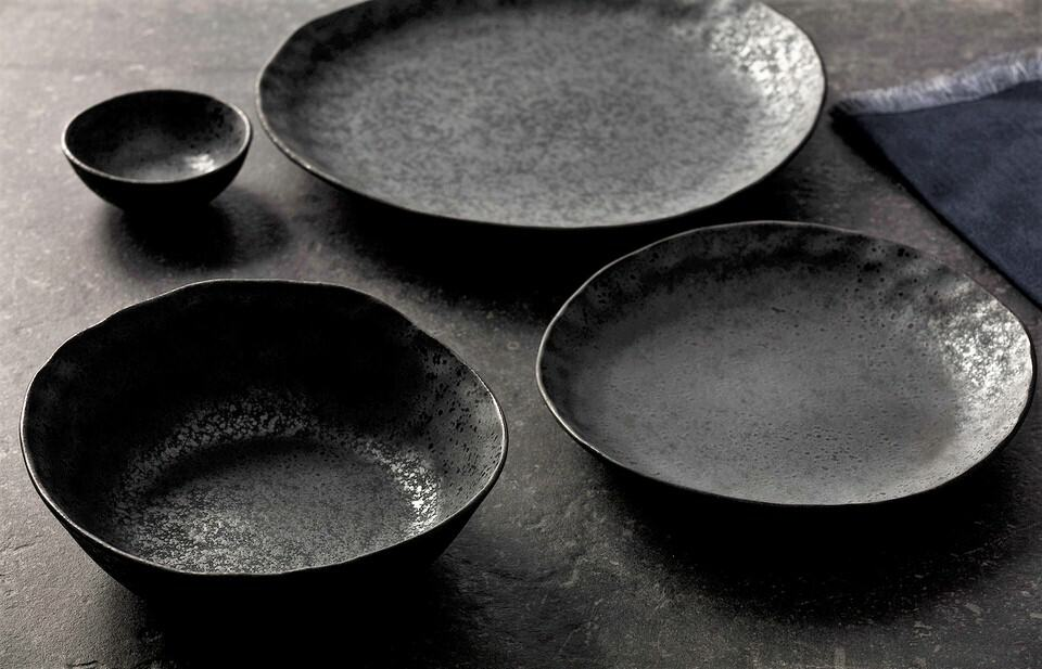 Beautiful Product Shot Of The Rania Collection Ceramic Dinner Plates And Bowls On A Dark