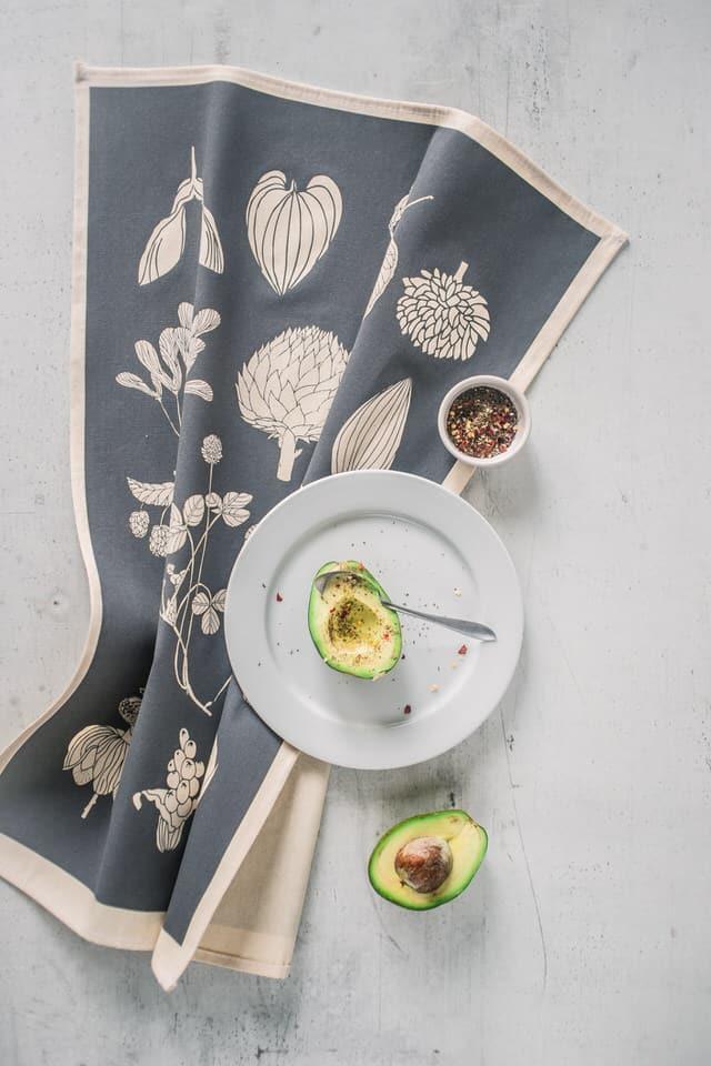 Lifestyle shot of Softer+Wild hand screen printed grey tea towel