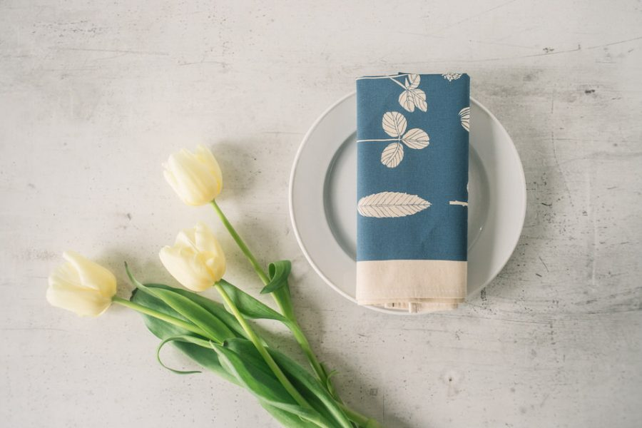 Lifestyle shot of Softer+Wild screen printed Softer+Wild screen printed aqua table napkin