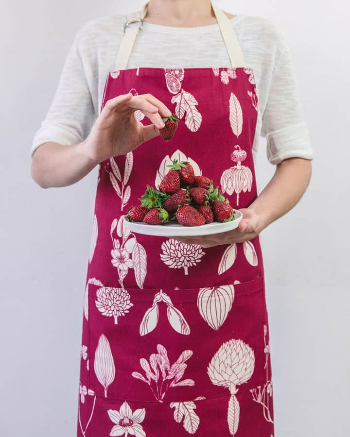 Modelled shot of Softer+Wild botanical print red apron