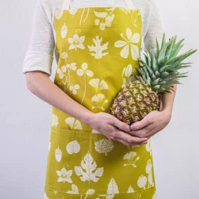 Modelled shot of Softer+Wild botanical print mustard apron
