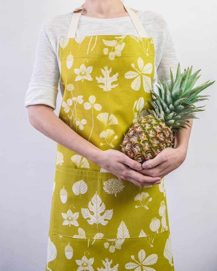 Modelled shot of Softer+Wild botanical print mustard apron