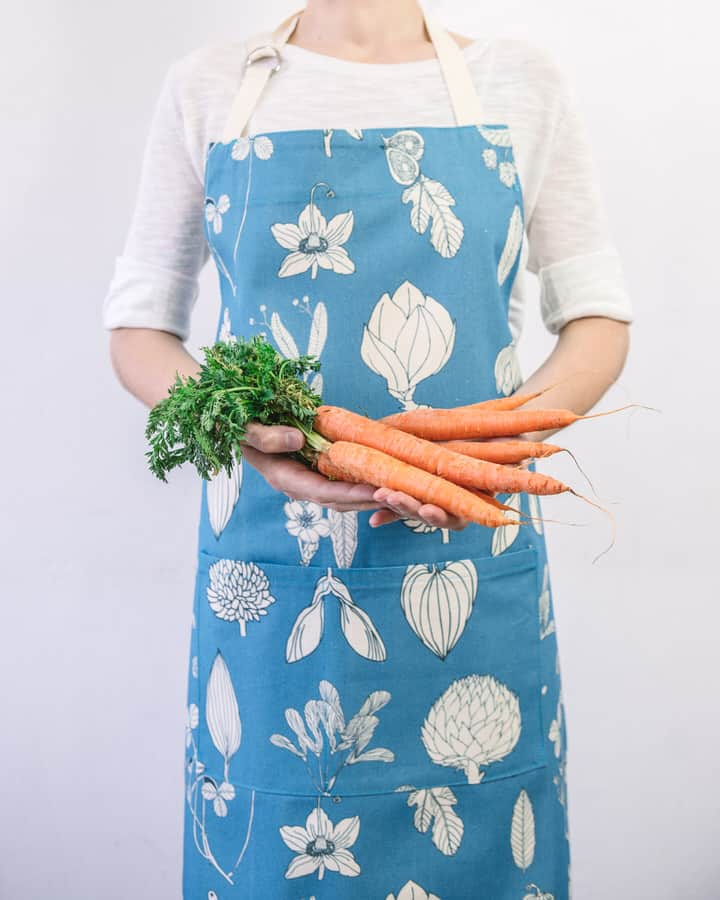 MOdelled shot of Softer and Wild botanical print sky blue apron