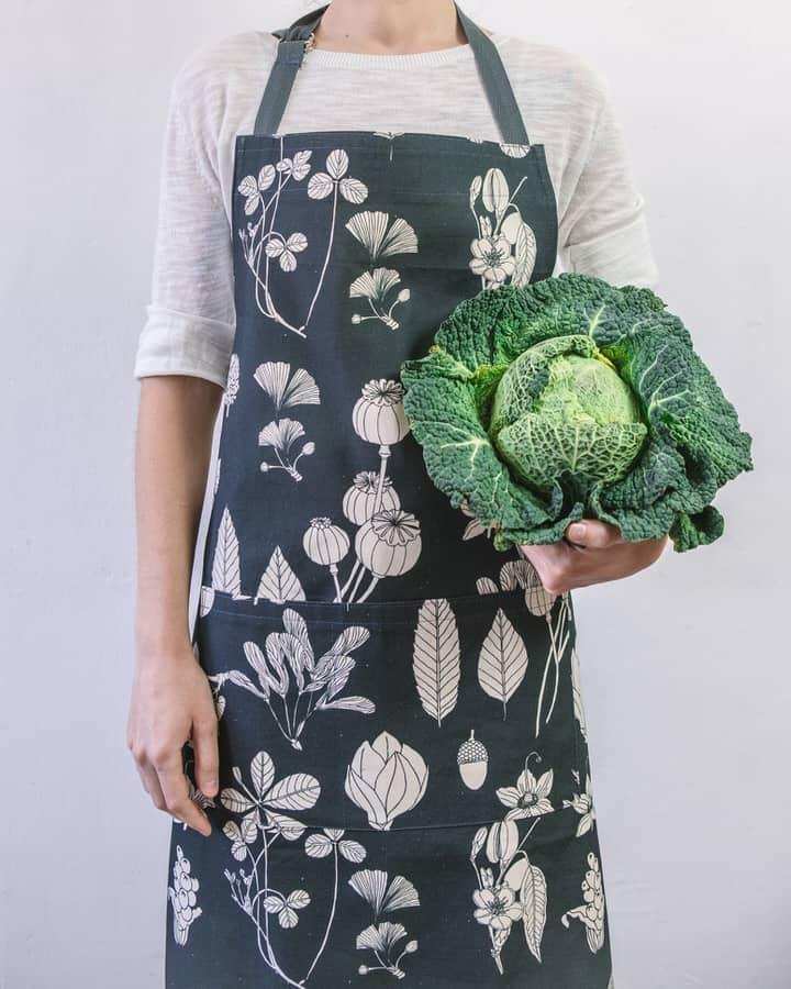 Modelled shot of Softer+Wild botanical print grey apron
