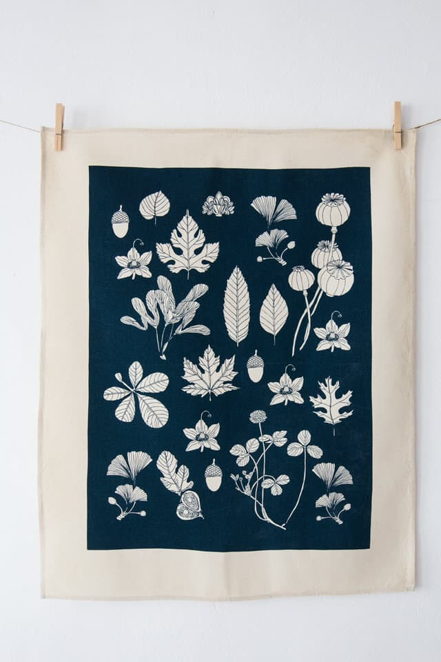Plain product shot of Softer+Wild hand screen printed blue tea towel