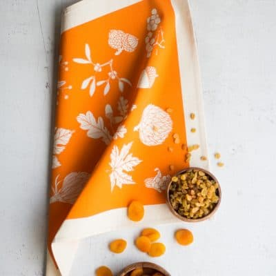 Lifestyle product image of Softer+Wild napkin in orange