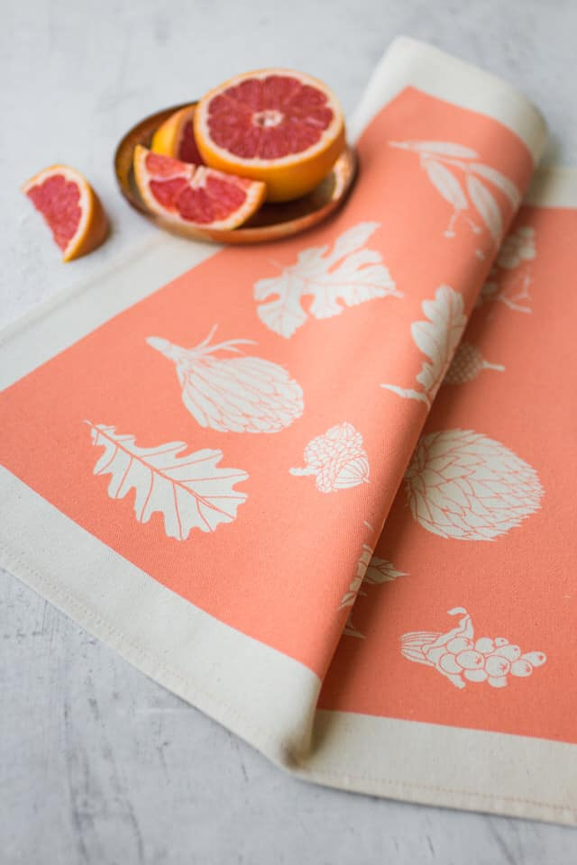 Lifestyle shot of Softer+Wild screen printed pink table napkin