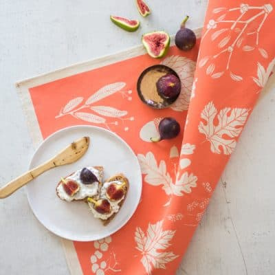 Lifestyle shot of Softer+Wild hand screen printed pink tea towel