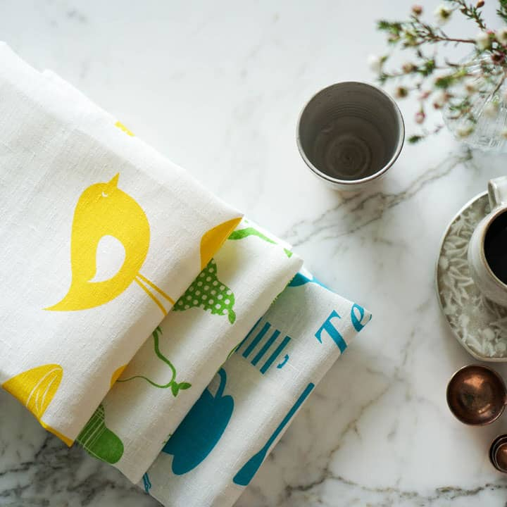 LIfestyle shot of Product shot of Vinyl Design collection of tea towels