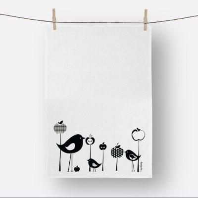 Product shot of Vinyl Design birds and apples linen tea towel in black