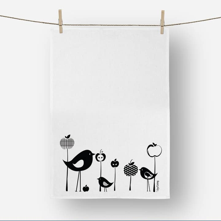 Product shot of Vinyl Design birds and apples linen tea towel in black