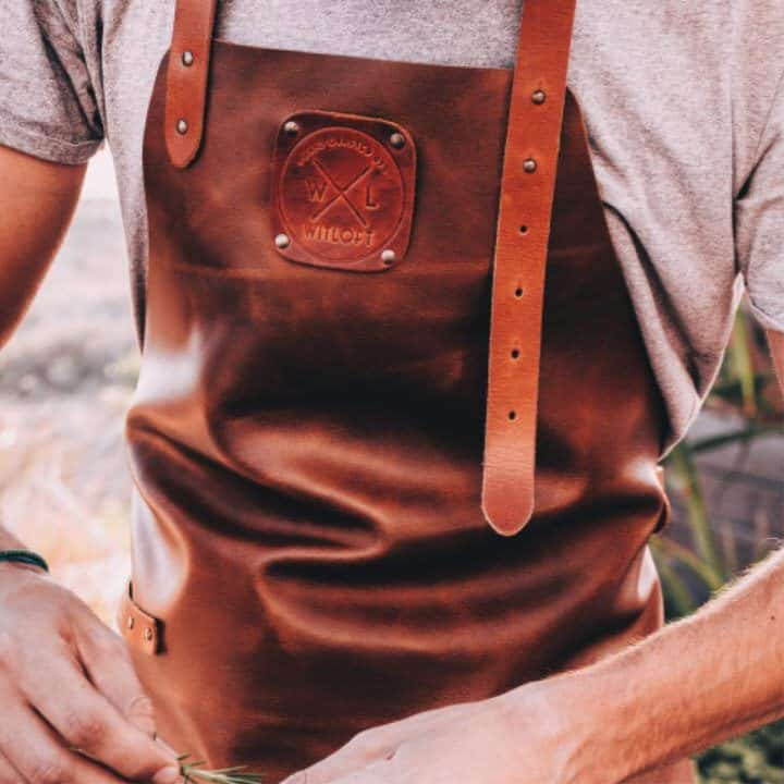 Close up Modelled shot of the WITLOFT Cognac leather apron