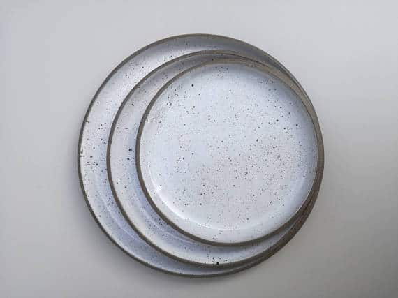 Sofia Ceramics aerial lifestyle product shot of the Goose egg ceramic dinner platess
