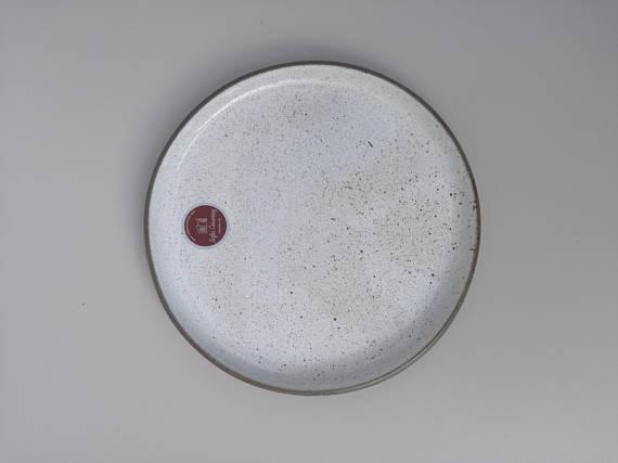 Sofia Ceramics aerial product shot of the Goose egg ceramic dinner plate with logo stamp
