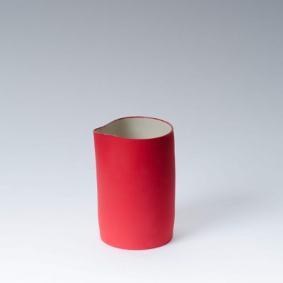 Product shot of porcelain red jug