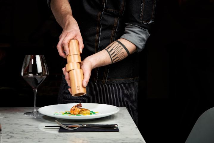 Lifestyle shot of the Off Axis pepper mill being used