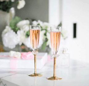 Product lifestyle shot of Gaby champagne glasses on table