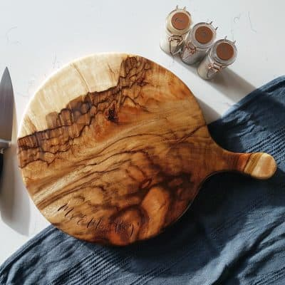 Large round wooden chopping board with handle