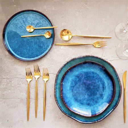 Table setting with Lifestyle shot of Golden cutlery set_16 piece and plates