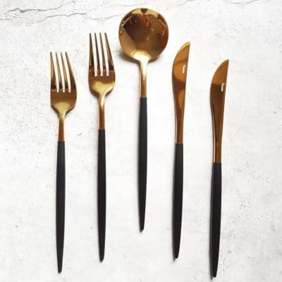 Product shot of golden black cutlery-set-knives forks spoons