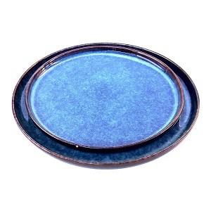 Plain angled aerial shot of two of the Australian Australian blue porcelain dinner plates