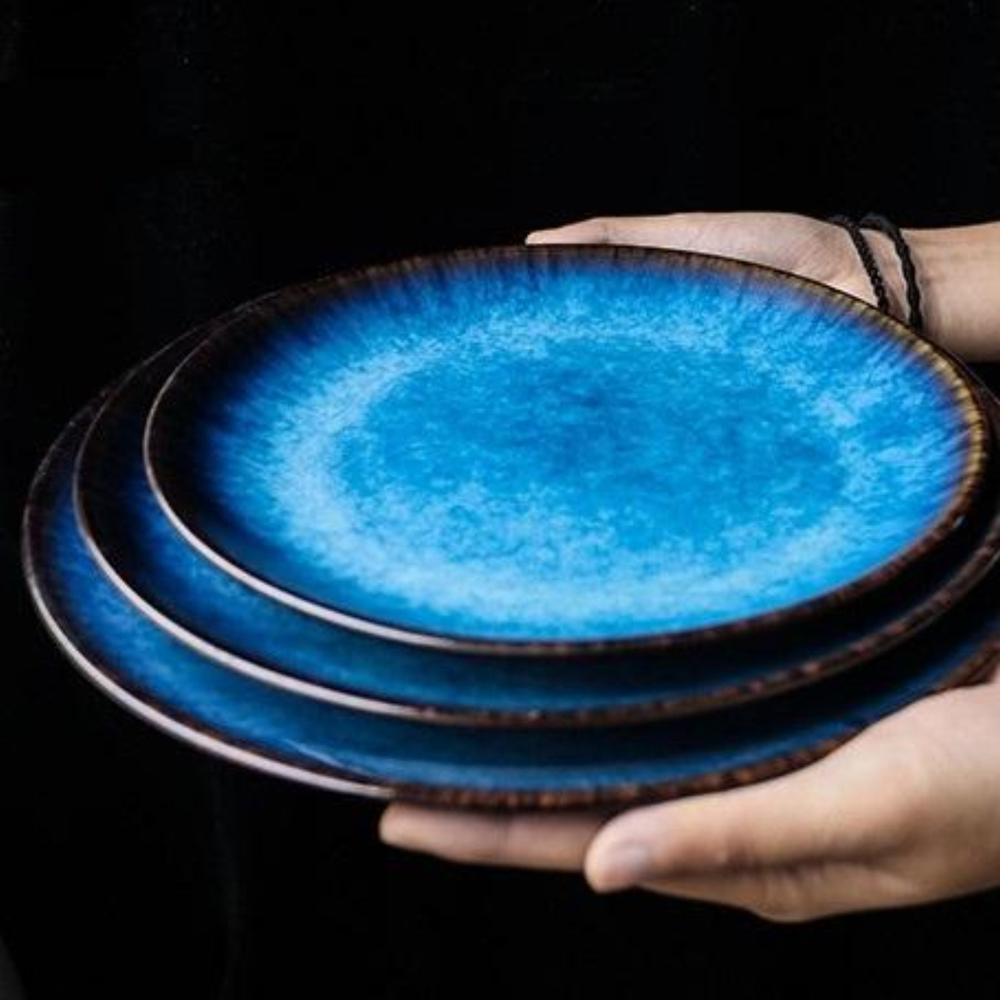 Lifestyle shot of Cosmic Down Porcelain dining plates