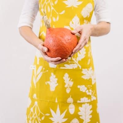 Botanical print apron in mustard