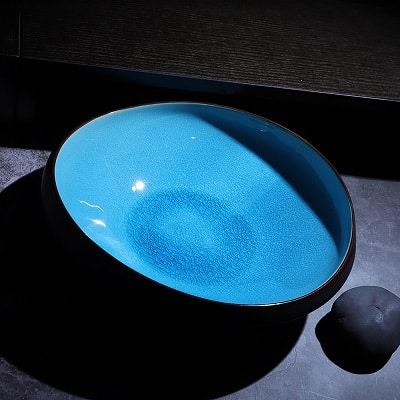 Top side lifestyle shot of the Aqua blue salad and pasta bowl