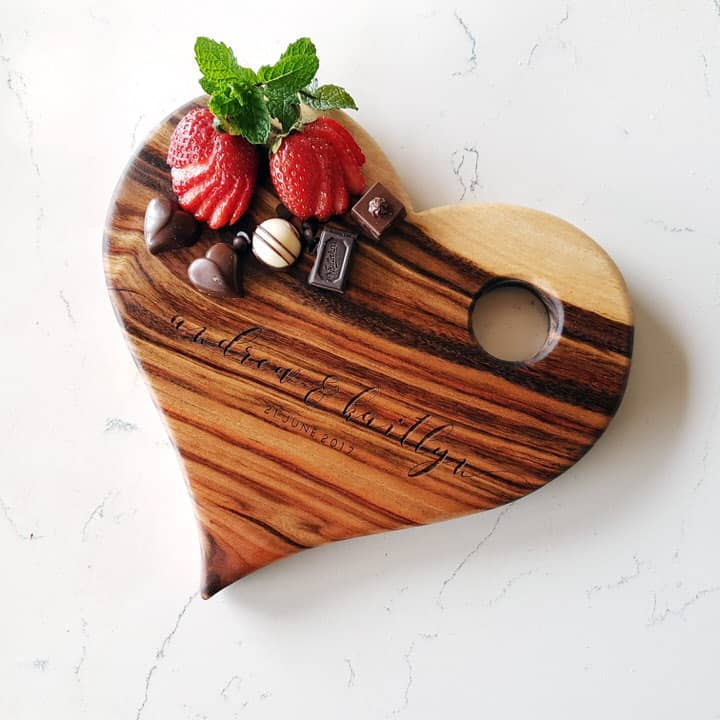 Personalised heart shaped wooden serving board with engraved name