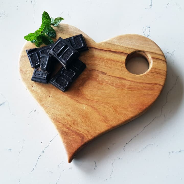 Blank heart shaped wooden serving board with chocolates