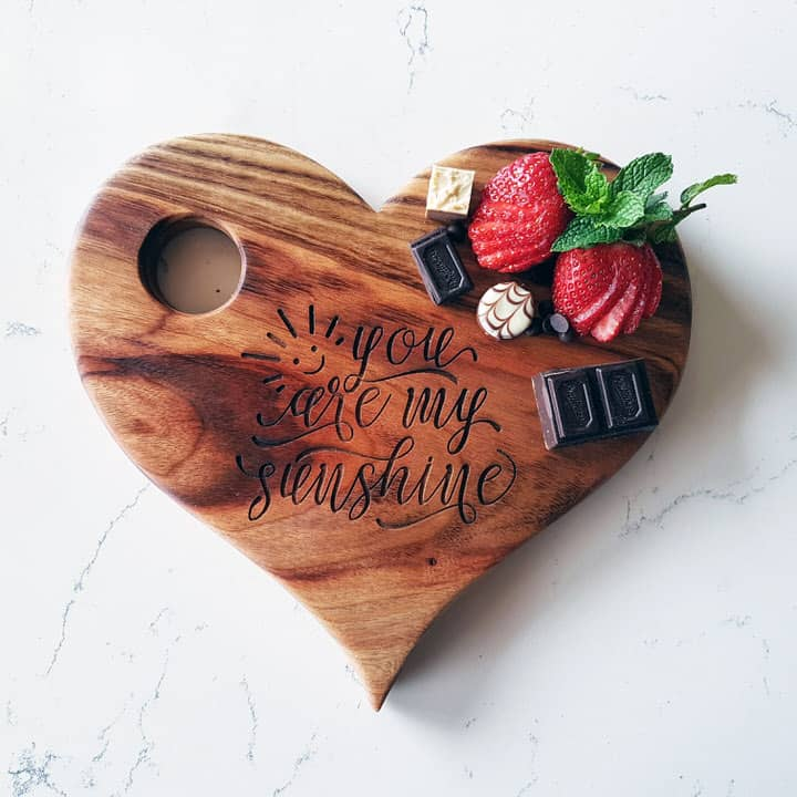 Personalised heart shaped wooden serving board with message