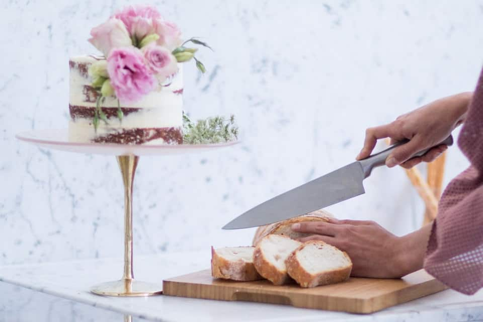 Pastel cake holder holding Easter brunch cake