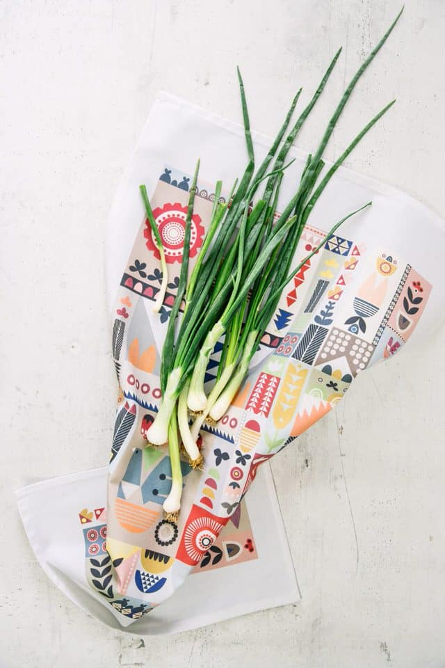 Garden tea towel with bunch of spring onions